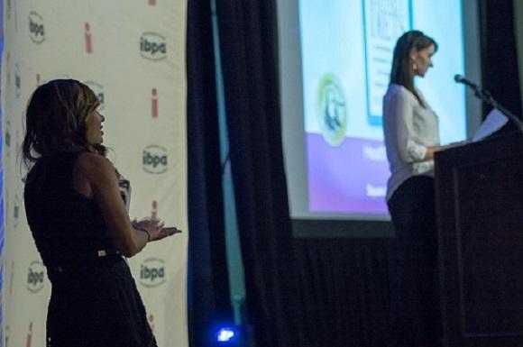 IBPA CEO, Angela Bole, (right) presents the 2016 Benjamin Franklin Book Awards in Salt Lake City, Utah. IBPA Project Coordinator, Mimi Le, (left) assists.