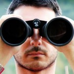 Man with binoculars Author-Blogging-IBPA