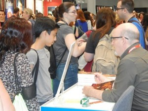 Lowell H. Press signed copies of his Benjamin Franklin Award winning book, THE KINGDOM OF THE SUN AND MOON, in IBPA's Cooperative Booth. (CLICK TO ENLARGE IMAGE)