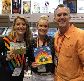 From left to right: Kathryn Kemp Guylay hangs out in IBPA's cooperative booth with fellow members Jackie and Todd Courtney