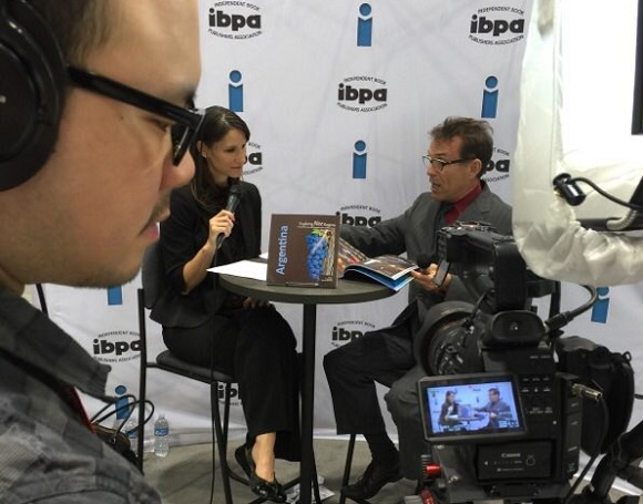 IBPA member Michael C. Higgins, PhD (right) is interviewed on camera by IBPA CEO Angela Bole (left) about his book, EXPLORING WINE REGIONS: ARGENTINA